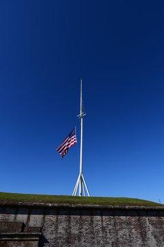 waving american flag on a pole