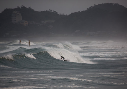 Japanese surfer in the contaminated area after the daiichi nuclear power plant irradiation, Fukushima prefecture, Tairatoyoma beach, Japan