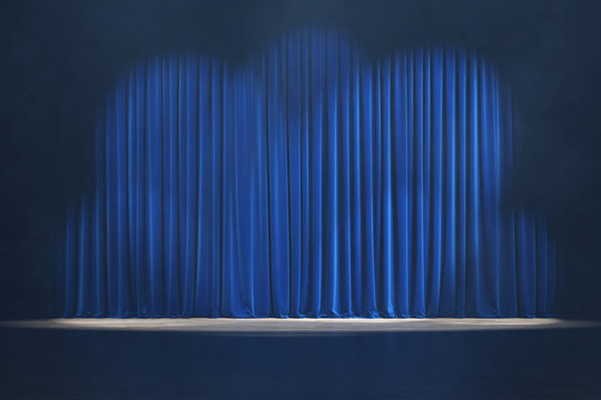 Theater stage with blue velvet curtains and volume light.