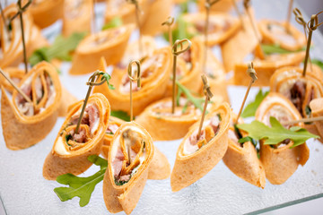 Buffet at the gala dinner. Assortment of canapes. Banquet service. catering food, snacks with smoked meat and sausage