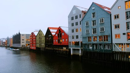 Wall Mural - Trondheim, Norway. City center of Trondheim, Norway during the cloudy winter day. Historical colorful building and grey cloudy sky