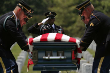 World War II veteran Carl Mann is buried on 75th anniversary of D-Day at Arlington National Cemetery in Virginia