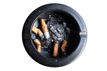 cigarette in an black ashtray on white background