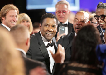 Denzel Washington is greeted at the 47th AFI Life Achievement Award gala honoring him in Los Angeles