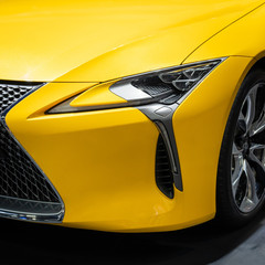 Headlights of yellow car.