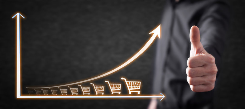 Shopping cart and growth graph. Increase in sales