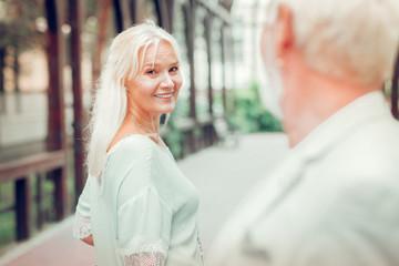 Happy nice woman looking at her beloved man