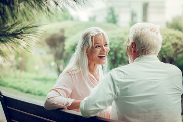 Cheerful delighted woman laughing with her husband