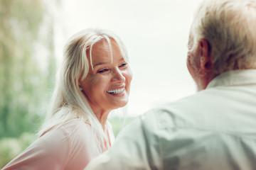 Joyful happy woman enjoying time with her husband