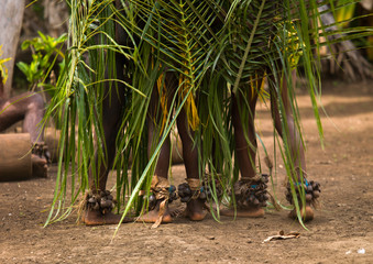 Small Nambas children covered with palm leaves dancing in front of slit gong drums, Malekula island, Gortiengser, Vanuatu