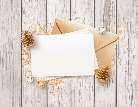Blank paper, rose gold envelope mockup design template with brown wooden table and Christmas decoration