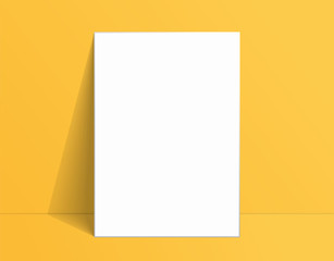 White poster mockup standing on the floor near yellow wall. Blank Canvas Mockup for design
