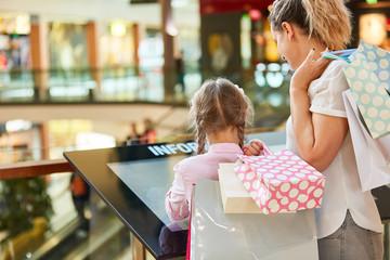 Family on touchscreen information kiosk