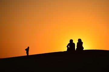 Silhouettes at sunset in the Arabian desert