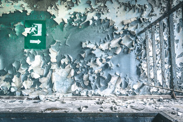 peeled paint on the wall of a building in Pripyat