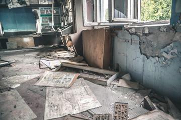 deserted technical room in mess in Pripyat