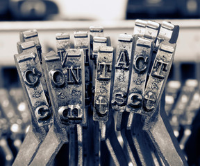 the word contact with old type writer