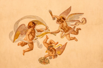 Fototapete - COMO, ITALY - MAY 11, 2015: The detail of baroque fresco of angels with the  instruments of martyrium in church Chiesa di San Orsola Gian Domenico Caresana (1616).