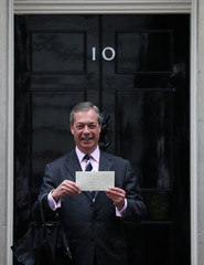 Leader of the Brexit Party Nigel Farage delivers a letter to Downing Street in London