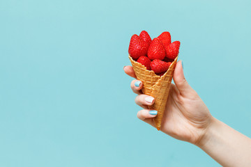 Woman holding waffle cones on color background. Fototapete