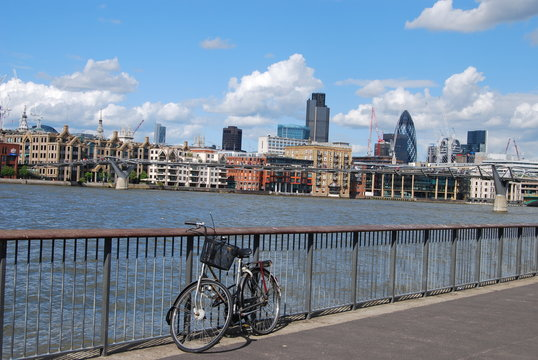Bicycle at railing on the background of the River Thames during the daytime, London, UK