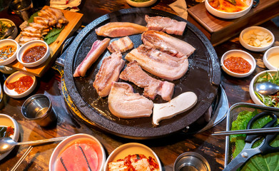 Pan-fried cooked black pork meal in Korea restaurant, fresh delicious korean food cuisine on iron...