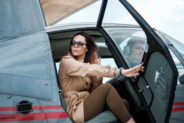 Business woman in aprivate a helicopter