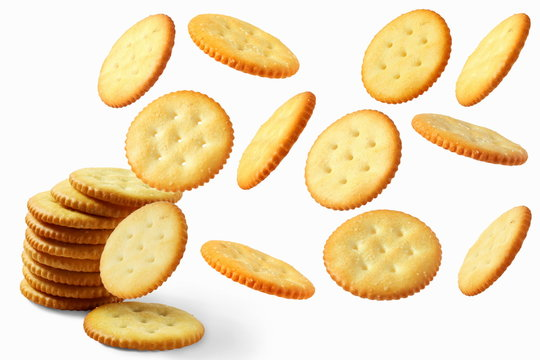 Top view of round salted snack cracker cookie isolated on white background