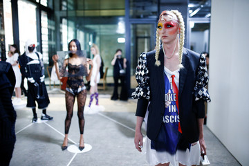 Models present creations during The Royal College of Art's Emerging Fashion Designer Show 'All at Once' in central London