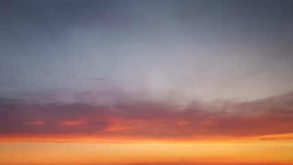 cloudscape at sunset with beautiful sky gradient and some clouds
