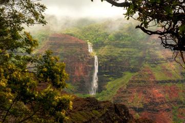 Waipo'o Falls, Waimea Canyon, Kauai, Hawaii. Waipo'o Falls is a fantastic waterfall on Kokee Stream dropping 800 ft. in two tiers. It is located in the heart of the Waimea Canyon.
