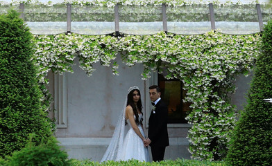 Arsenal midfielder Mesut Ozil and his fiancee Amina Gulse pose for wedding pictures before their wedding ceremony in Istanbul