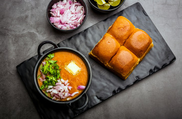 Indian spicy fast food / snacks Pav Bhaji with bread, onion and butter