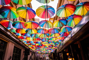 Colorful umbrellas in the sky of the Victoria Passage, in Bucharest city centre, Romania