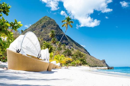 Tropical beach with beach chairs on the beach Saint Lucia, St lucia beach with tropical beach chairs luxury vacation Sugar beach
