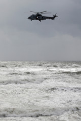 An helicopter flies over the sea as part of rescue operations during the storm Miguel, off the coast of Les Sables d'Olonne