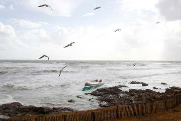 A view shows a capsized sea-rescue boat of the SNSM during the storm Miguel in Les Sables-d'Olonne