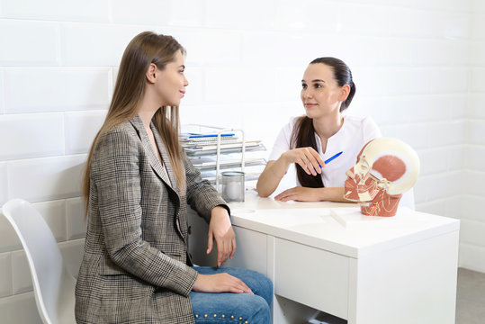 Professional cosmetologist. Female beauty doctor talking to her customer young woman while working in the beauty clinic. Cosmetology concept