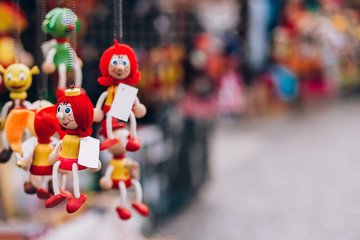 wooden toy dolls in the gift shop. Traditional handicraft puppet dolls are sold on the market in Prague, Czech Republic
