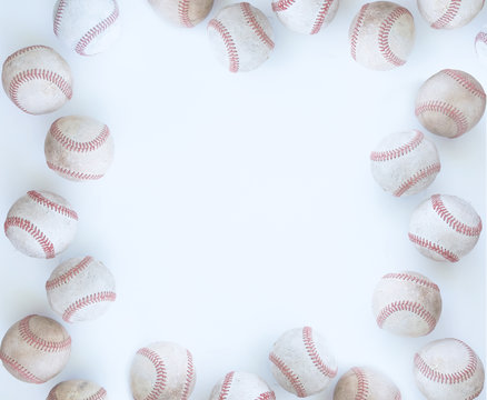 Baseball border on white background with balls and copy space for sports graphic or banner.