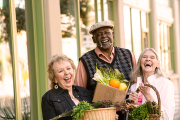 Laughing Seniors Returning from Farmers Market with Groceries