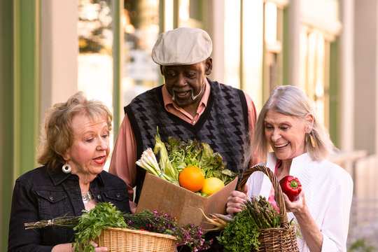 Seniors Comparing Purchases from Farmers Market
