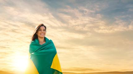 Woman with brazilian flag, brazilian fan Wall mural