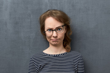 Portrait of confused girl making silly face