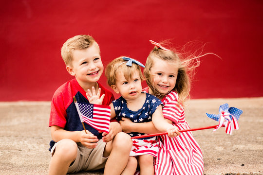 Cute Kids holding mini American flags