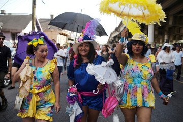Fans of the late musician Dr. John march through the Treme neighborhood during a second-line parade celebrating the late New Orlean musician Dr. John in New Orleans
