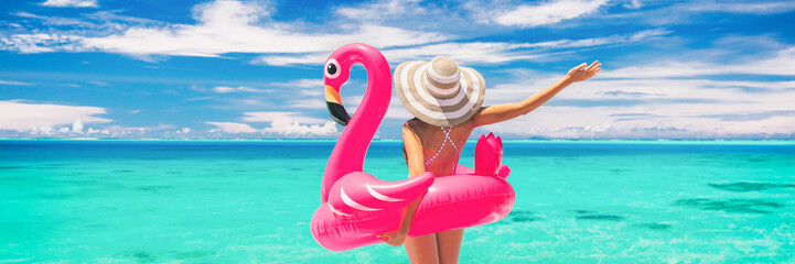 Happy summer vacation fun woman tourist enjoying travel holidays on beach banner background ready for swimming pool with flamingo float - funny holiday concept. Fototapete