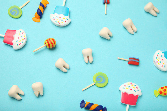 Teeth with sweet candies. Tooth caries in children's, dental healthcare.
