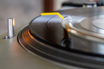 LP turning on record player