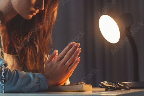 Religion woman folded her hands in prayer  Praying with the